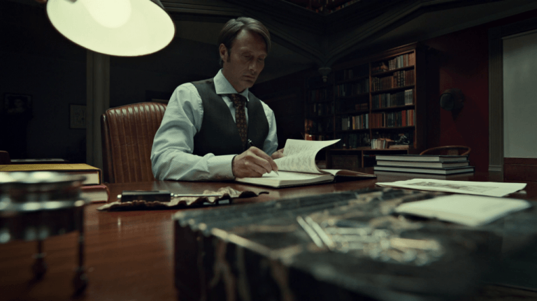 hannibal-lecter-writing-in-his-notebook