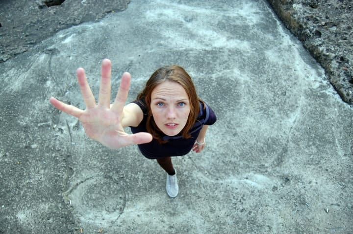woman reaching out of her comfort zone