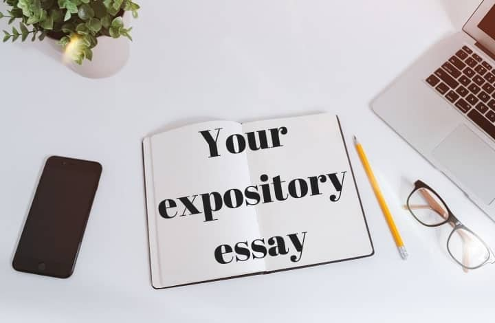 notebook on a table with an essay headline on it