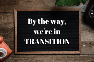by the way we're in transition - words on a blackboard