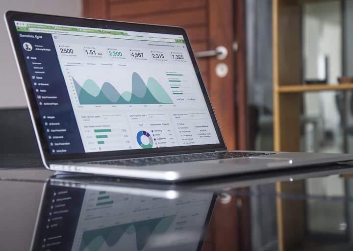 computer with analytics on a glass table