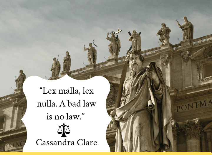 building with statues and law quote