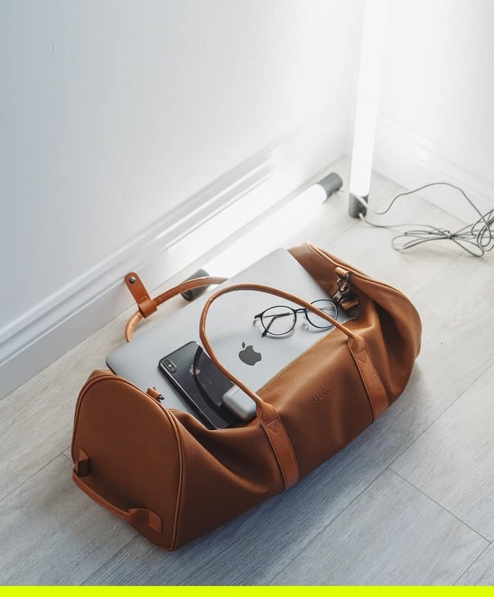 a duffel bag with a laptop in it