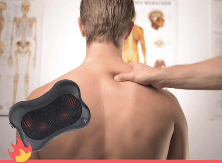 a person's back and a shiatsu back massager in the forefront