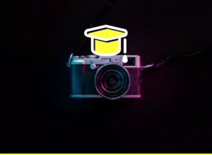a camera with a college graduation hat on it - featured image