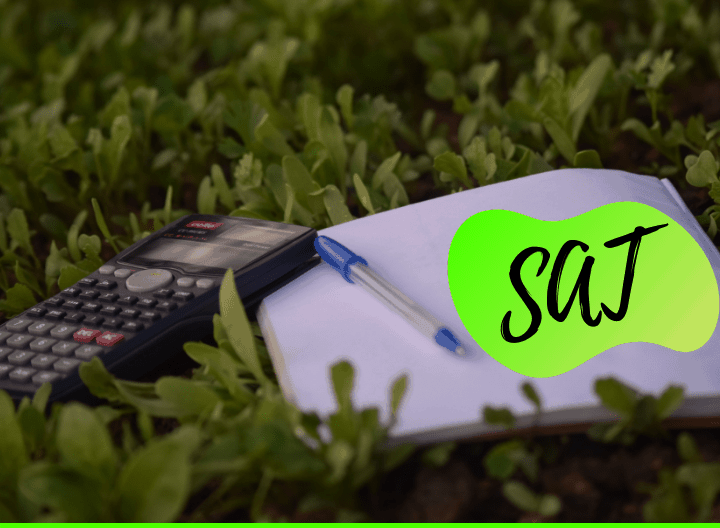 calculator lying on the grass with a notebook and sat letters - featured image