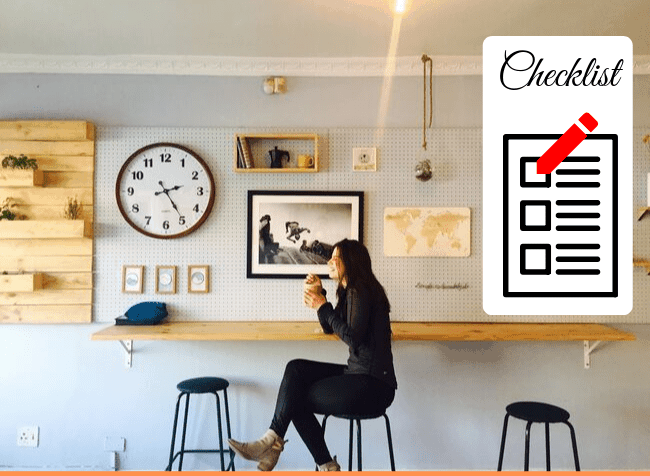 girl sitting in a cafe and checklist on a wall - featured image