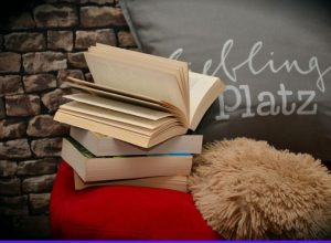 books lying on a pillow - featured image