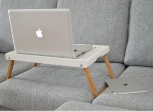 computer tray table on a couch - featured image