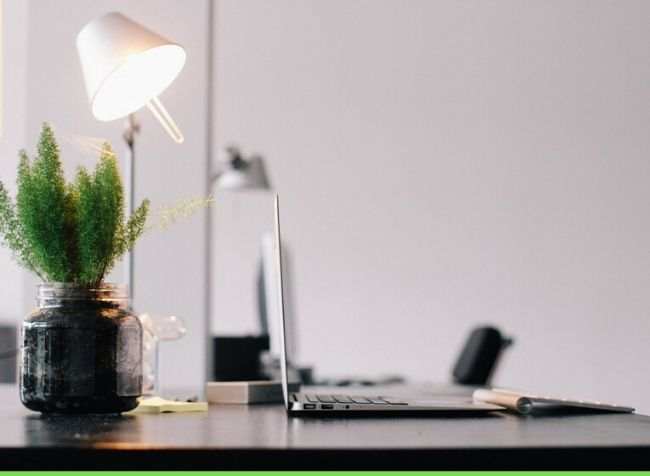 natural modern office lamp on a desk with a laptop - featured image