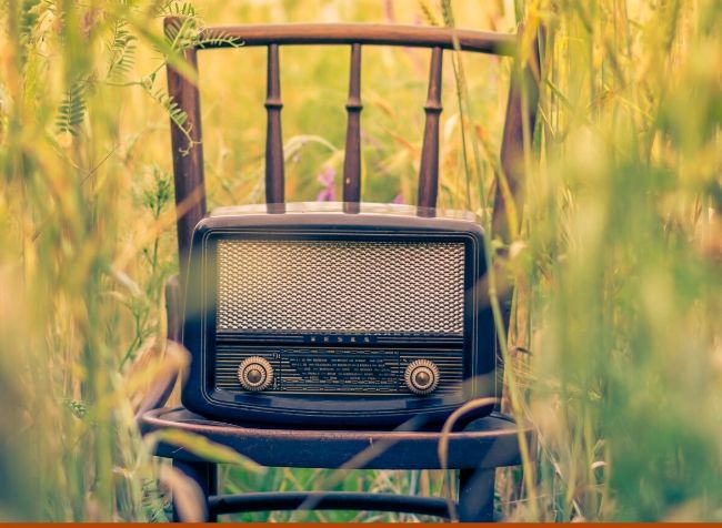 vintage speaker on a chair - featured image