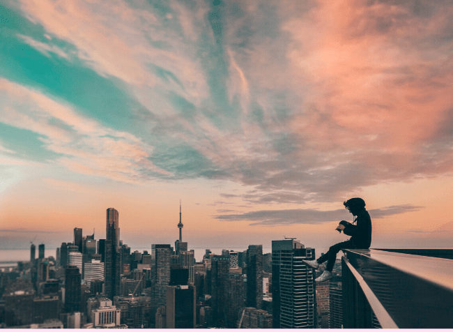 person sitting on a rooftop - featured image