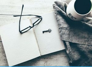 morning cup of coffe and a notebook for writing
