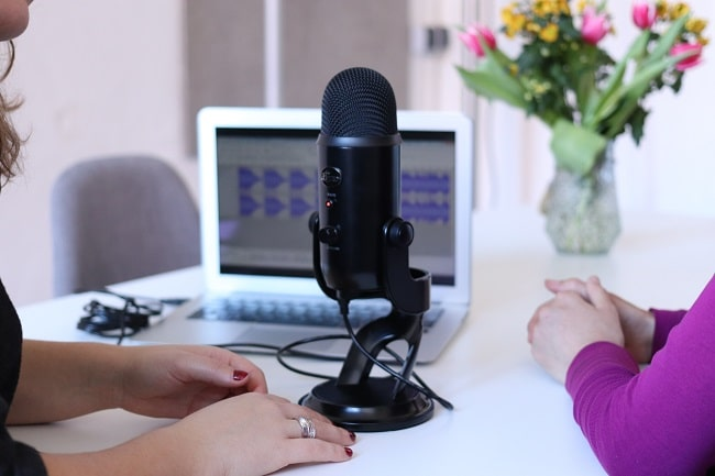 recording with black condenser microphone