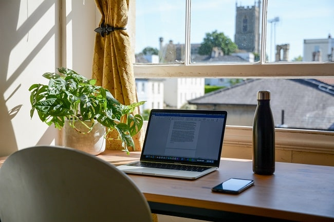 home office desk with a laptop