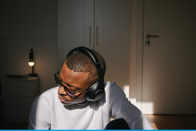 man with headphones and glasses