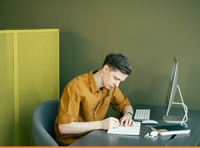 man writing outline
